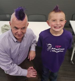 Executive gets purple mohawk to benefit kid with autoimmune disease